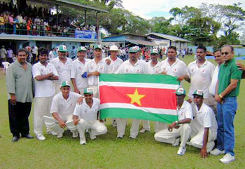The Surinam squad celebrate after their victory over Turks and Caicos