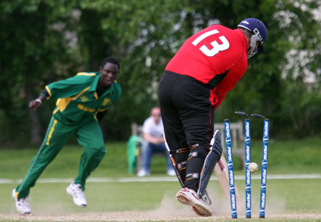 Christian Rocca of Gibraltar is bowled by Nigeria's Oluseye Olympio (© CricketEurope)