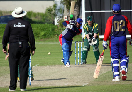 Qamar Saeed drives during his unbeaten 60 in the Final against Guernsey (© CricketEurope)