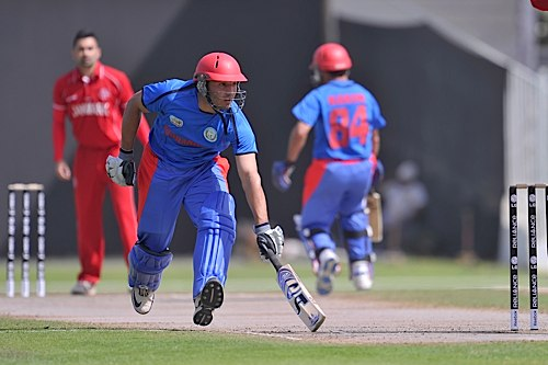 Afghanistan's Karim Sadiq makes his ground against Denmark in 2012
