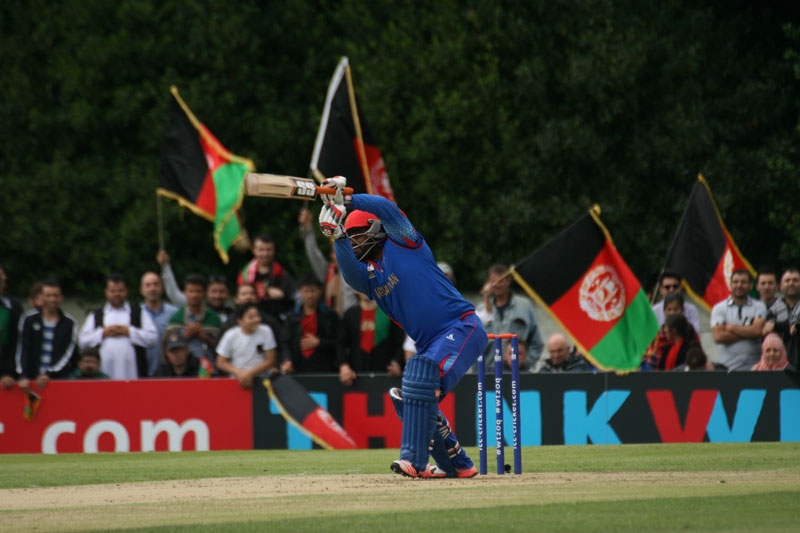 Mohammad Shahzad cover drives during his innings against Scotland in 2015