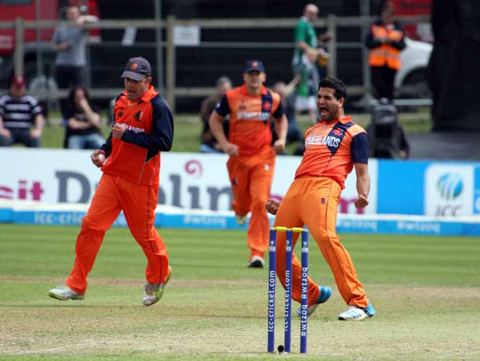 Mudassar Bukhari celebrates one of his four wickets for The Netherlands against Ireland