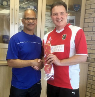 Gary Kynman presents a Jersey Cricket Board tie to the Chairman of Ottoman CC