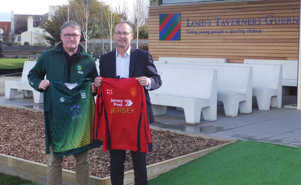 Mark Latter (Guernsey Cricket CEO) and Wayne Gallichan (InfrasoftTech, Senior Business Development Manager) in front of the Lord's Taverners (Guernsey) Pavilion at KGV