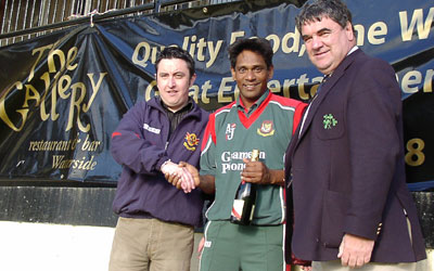 Mohammad Rafique receives the trophy