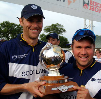 Holding the ICC Trophy with Ryan Watson in 2005